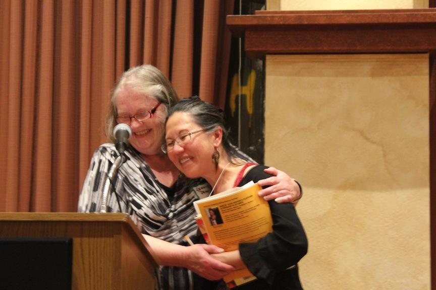 Festival Director Lennie Dean hugs Playwright Teresa LeYung-Ryan photo by Jonathan Hayden