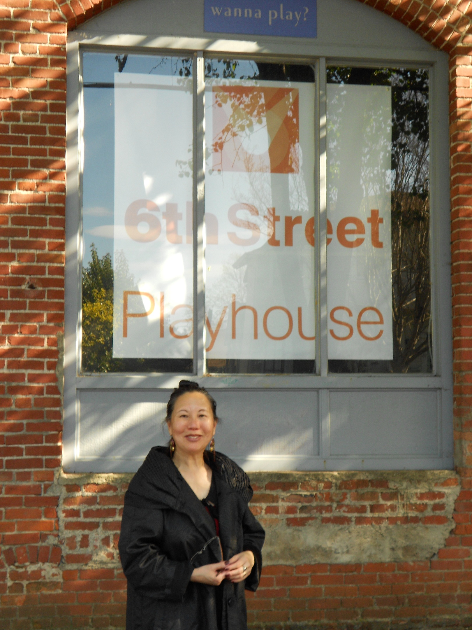 Playwright Teresa LeYung-Ryan cheers for Redwood Writers Play Festival and 6th Street Playhouse--photo by Elisa Sasa Southard